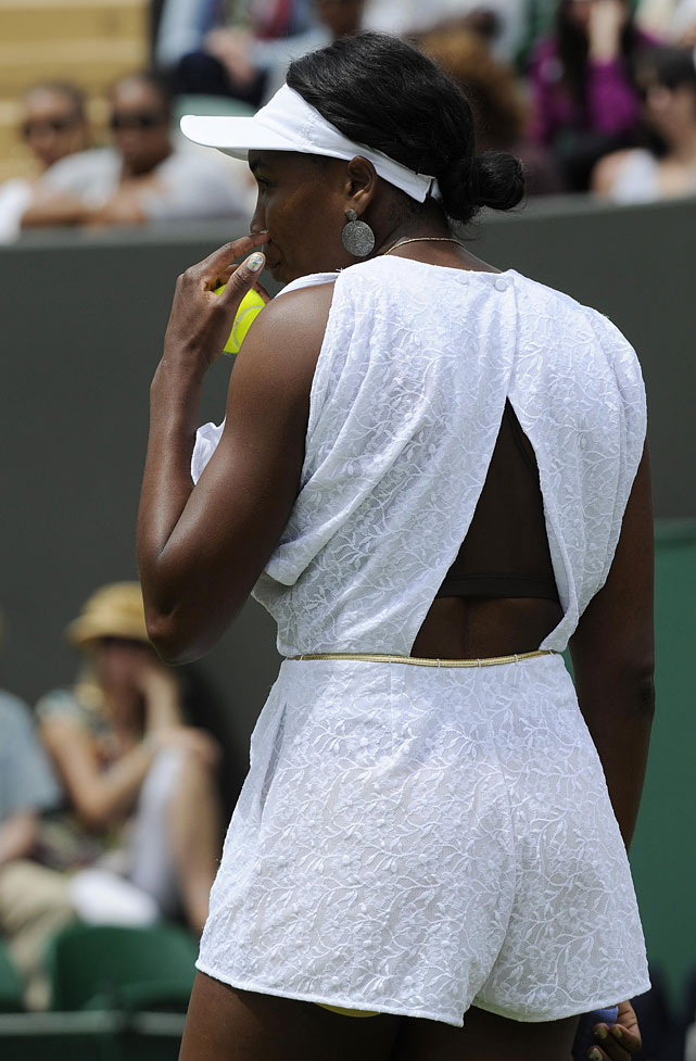 Venus Williams prepares to serve to Uzbekistan's Akgul Amanmuradova during their first-round match.