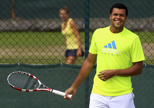 Jo-Wilfried Tsonga of France trains on a practice court on Thursday at the All England Club.