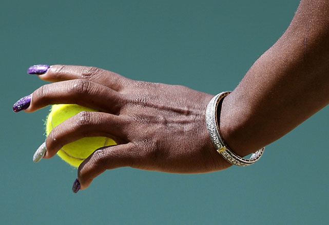 Serena Williams prepares to serve during her second-round match with Romania's Simona Halep.