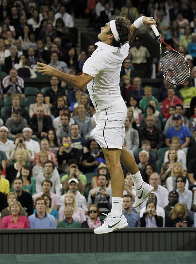 Roger Federer leaps to make a forehand return to France's Adrian Mannarino during their second-round match.