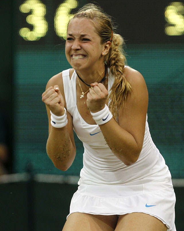 Germany's Sabine Lisicki reacts after defeating China's Li Na on Centre Court.