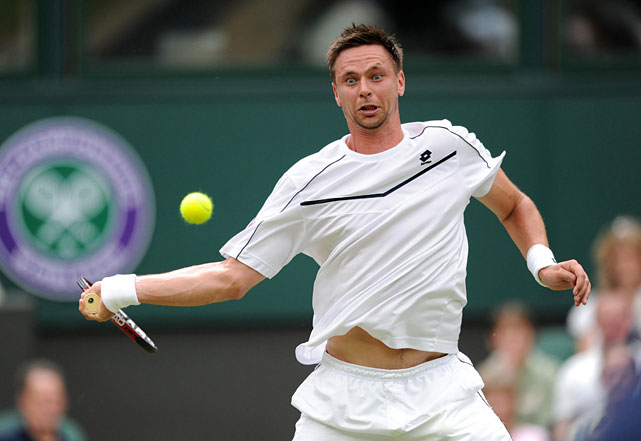 Robin Soderling returns to Lleyton Hewitt during Thursday's match.