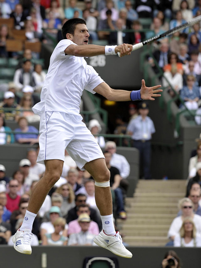 Serbia's Novak Djokovic returns a shot to South Africa's Kevin Anderson during their second-round match.