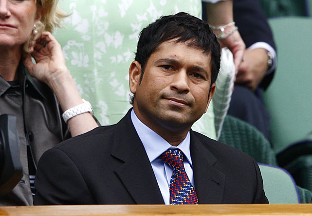 Cricketer Sachin Tendulkar takes in Wimbledon from the Royal Box.