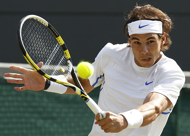 Spain's Rafael Nadal returns a backhand shot to Mardy Fish of the United States in their quarterfinal match.