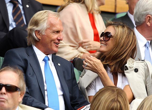 Former golfer Greg Norman watches the Tsonga-Federer match with wife Kirsten.