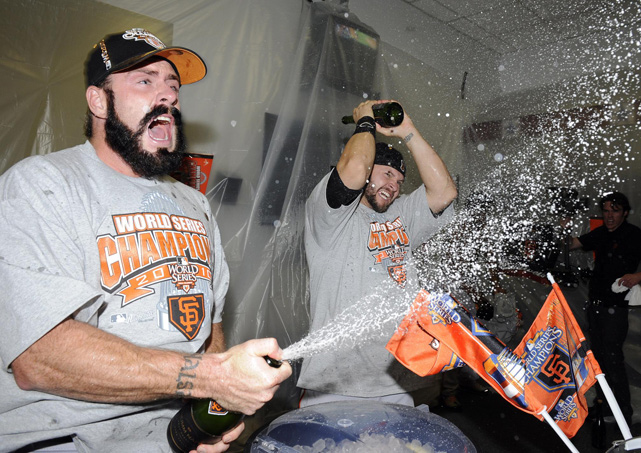 Wilson and teammate Cody Ross, center, celebrate with champagne in the locker room after winning the 2010 World Series.