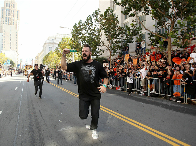 Wilson runs down a San Francisco street during the team's 2010 victory parade. The righty had six saves and a 0.00 ERA during the postseason.