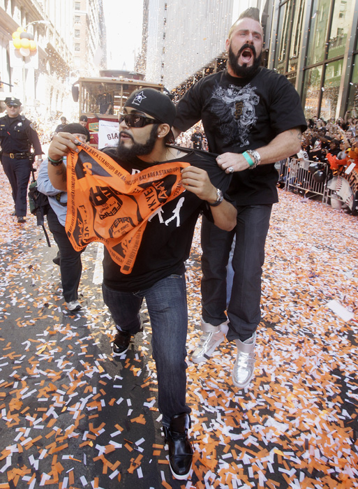 Wilson, right, and teammate Sergio Romo celebrate in the San Francisco streets during the Giants' 2010 World Series victory parade.
