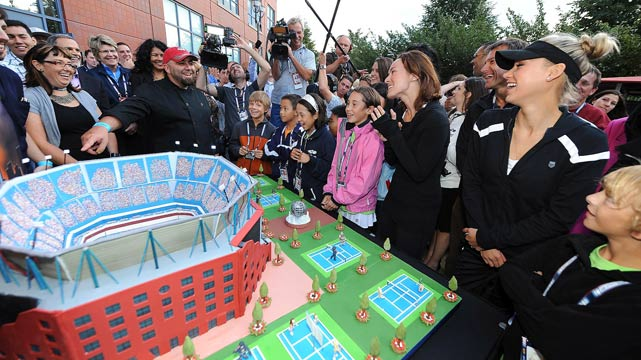 Martina Hingis and Anna Kournikova check out a huge cake in the shape of Arthur Ashe Stadium, another creation by chef Duff Goldman.