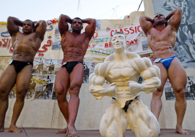 Iraqi bodybuilders posed with this cake of Arnold Schwarzenegger for his 57th birthday.