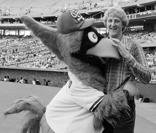 Despite the season's disappointing ending, Bird had gained national prominence as one of the top players in college basketball. Bird is greeted here by St. Louis Cardinals Mascot Fredbird during a game at Busch Stadium.