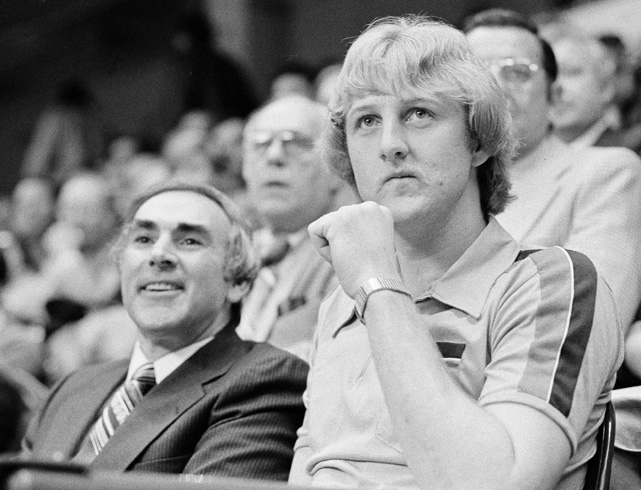 Bird also caught the eye of Boston Celtics general manager Red Auerbach, who drafted him with the sixth overall pick of the 1978 NBA Draft. Bird, seen here in the stands of a Celtics game with manager Bob Wolf, decided to put Boston on hold and return to Terre Haute for his senior year.