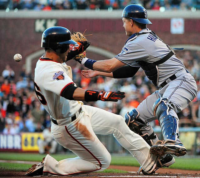 Padres catcher Nick Hundley can't corral the throw in time to tag San Francisco Giants center fielder Andres Torres during the first inning of the July 5 game. The Padres would bounce back from the first-inning 2-0 hole to win 5-3.
