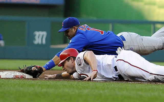 Laynce Nix just beats the tag by Chicago Cubs third baseman Aramis Ramirez in a game at Nationals Park on July 5. Ryan Zimmerman would score on the first-inning play and the Nationals would go on to win 3-2.