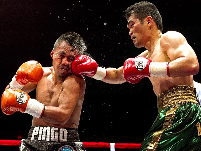 Brian Viloria of Hawaii and Julio Cesar Miranda of Mexico had an epic 12-round match for the WBO flyweight title on Saturday. Viloria, seen striking Miranda in the 3rd round, eventually won.