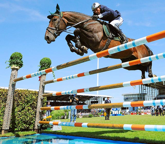 German equestrian Hans-Dieter Dreher and his horse Magnus Romeo leap over a hurdle during the CHIO show jumping for the North Rhine-Westphalia Prize in Aachen, Germany. Dreher finished in second place.