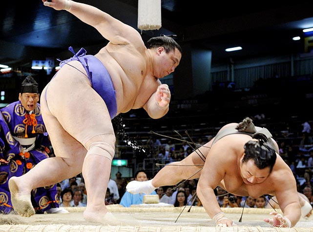 Ozeki Kaio throws down Toyonoshima at the Aichi Prefectural Gymnasium in Aichi Prefecture during the Nagoya Grand Sumo Tournament. Kaio ended up pinning Toyonoshima and matched former yokozuna Chiyonofuji for the most career wins, with 1,045.