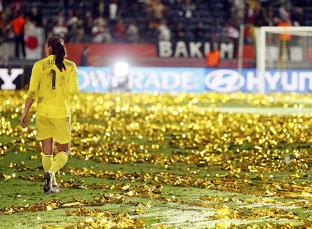 U.S. star goalkeeper Hope Solo walks off the confetti-soaked field in disbelief after her squad lost the World Cup final soccer match against Japan.