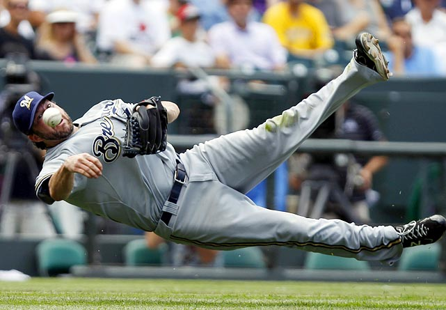 Milwaukee Brewers starting pitcher Shaun Marcum makes a diving, off-balance throw to first base to nail Colorado Rockies outfielder Dexter Fowler in one of the best defensive plays of the week.