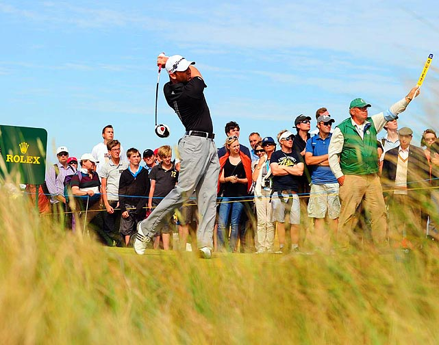 Ben Curtis admires his shot on the 17th hole during the second round of the British Open golf championship at Royal St George's in Sandwich, England. Darren Clarke ended up winning the event.