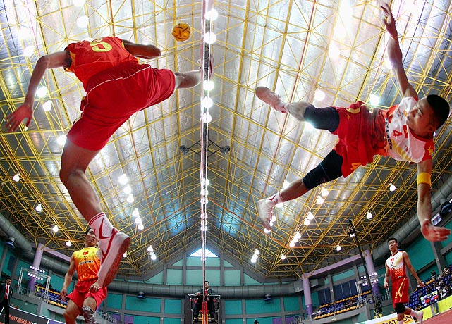 Vietnam's Thanh Man Chu kicks over the net against China's Mao Hui Wang during the ISTAF Sepaktakraw World Cup in Kuala Lumpur, Malaysia on July 22.