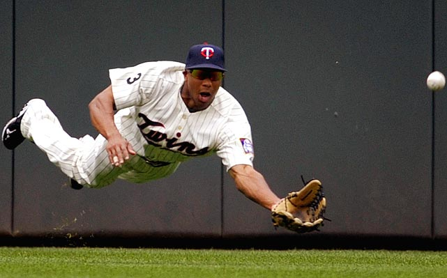 Minnesota Twins outfielder Ben Revere doesn't go by land or sea but air as he dives for a Miguel Cabrera hit during the first inning against the Detroit Tigers on July 23.