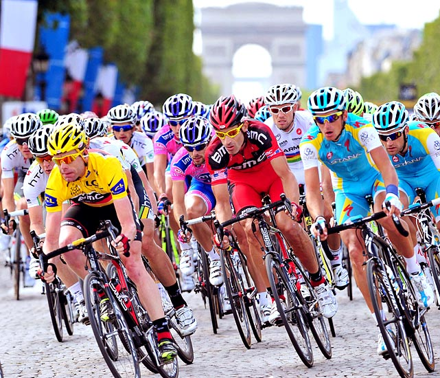 BMC Racing's Cadel Evans (yellow) races in the park in the final stage of the Tour de France. Evans became the first Aussie to win the event after taking the lead in the next-to-last day.