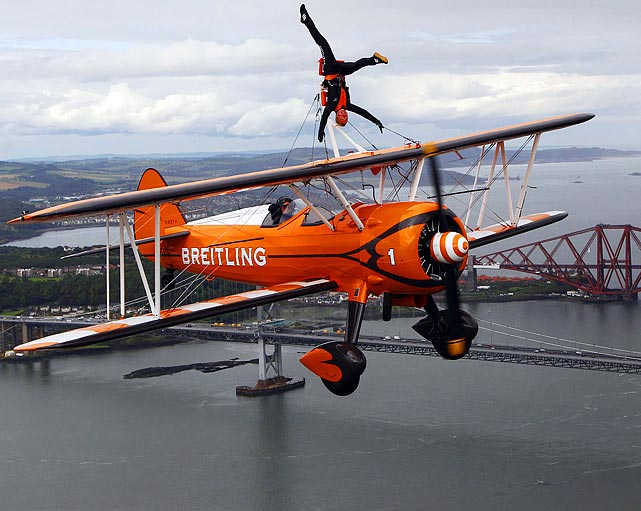 Wingwalker Charlotte Voce prepares for the airshow over the Firth of Forth at Scotland's National Museum of Flight on July 22.