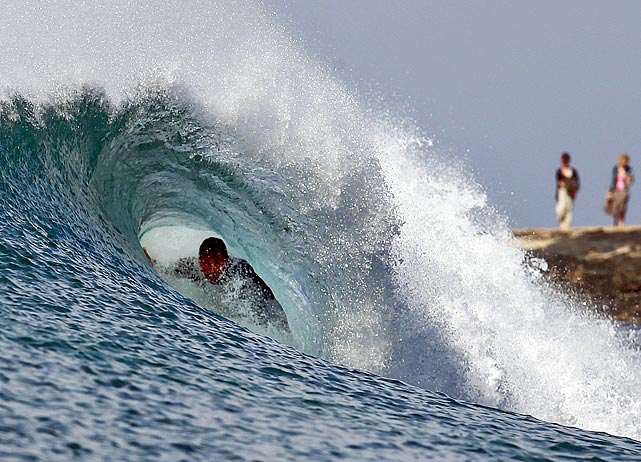 One of the world's top 34 surfers rides in the tube during Round 3 of the Billabong Pro at Jeffreys Bay, South Africa, on July 22.