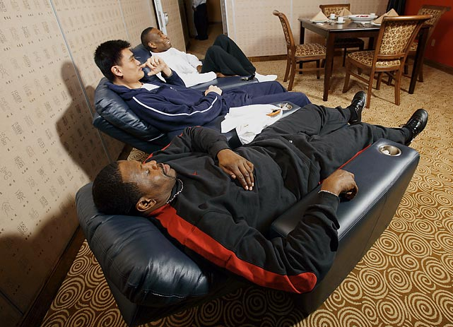 Yao Ming relaxing with Dikembe Mutombo and Patrick Ewing at Yao's Restaurant & Bar.