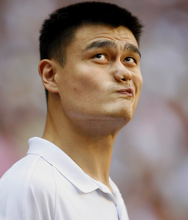 Yao Ming looks on as he watches the Houston Texans host the Detroit Lions at Reliant Stadium.