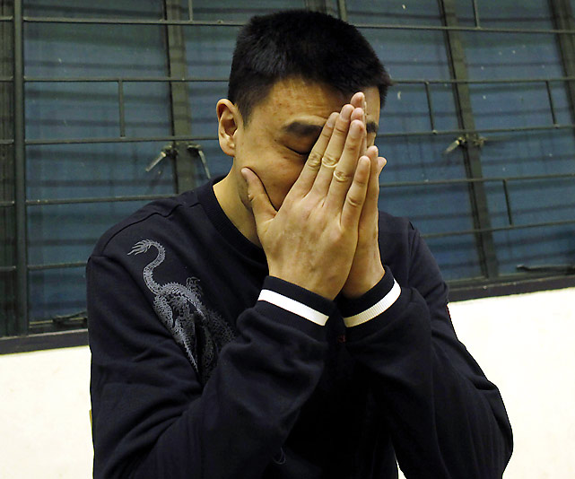 Yao Ming attends a news conference in Shanghai during which he spoke about his contract with the Houston Rockets.
