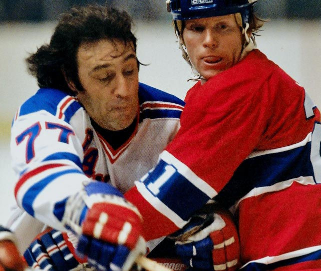 Another classic case of doubling up when the number you want already belongs to a legend. Espo had worn 7 with the Boston Bruins, but after his trade to the New York Rangers in 1975, he realized it belonged to future Hall of Famer Rod Gilbert. After trying 12, Espo rolled with two sevens on his back for the next five seasons. (Somewhat the same thing later happened in Boston when defenseman Ray Bourque relinquished Esposito's 7 upon its retirement at an emotional ceremony in 1987 and donned 77.)