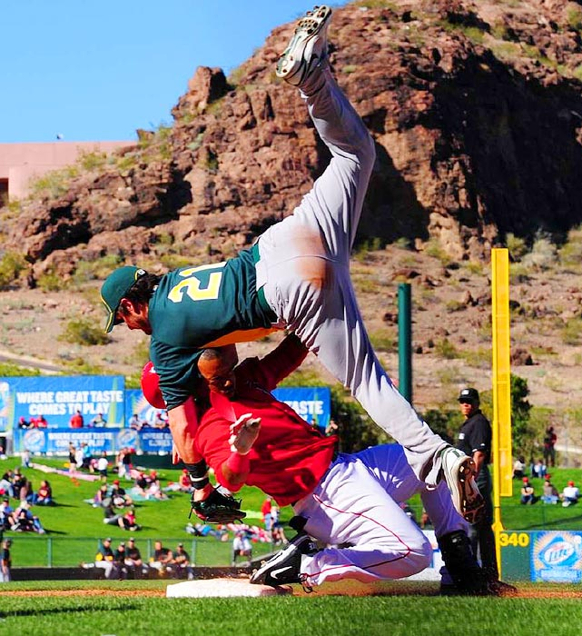 Jean Segura of the Angels and Andy Laroche of the Athletics collide during Spring Training in 2011.