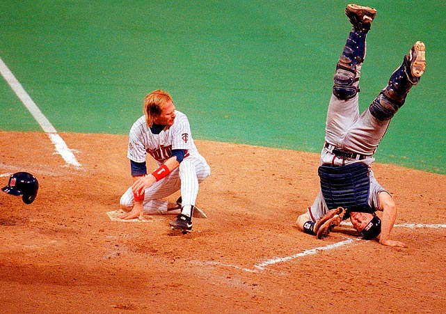 Braves catcher Greg Olson tagged out Dan Gladden of the Twins-- and struck an acrobatic pose -- during the 1991 World Series.