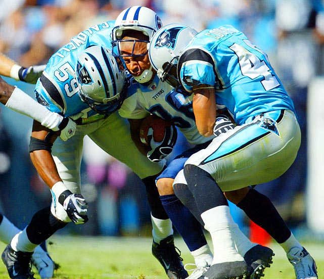 Titans WR Justin McCareins gets by Mike Caldwell (59) and Jarrod Cooper (40) of the Carolina Panthers in 2003.