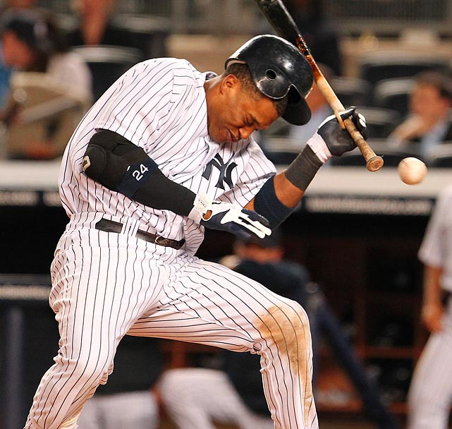 Yankees second baseman Robinson Cano (24) is hit by a pitch in 2011 against the Royals.
