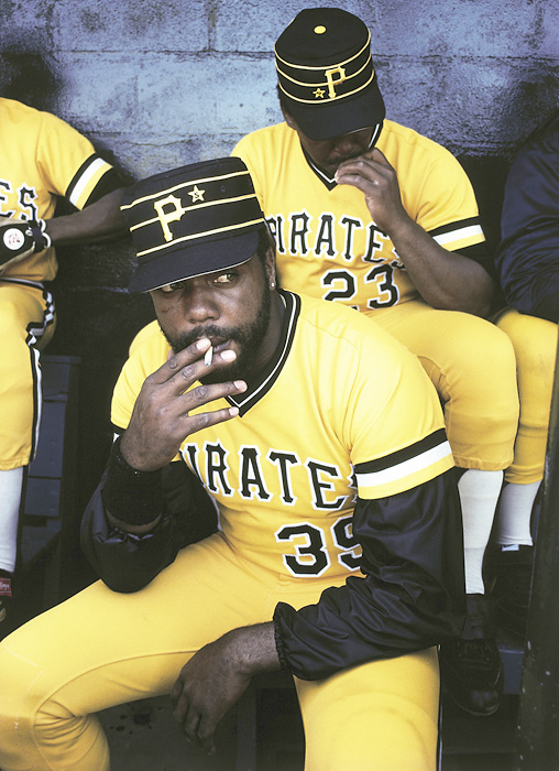 Dave Parker has time for a quick cigarette in the dugout before a spring training game in 1980.