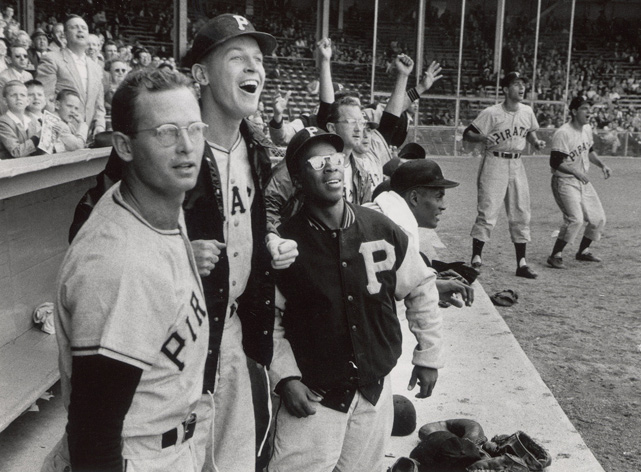 The Pirates' dugout celebrates as Dale Long hit his seventh home run in seven consecutive games against the Phillies on May 26, 1956.