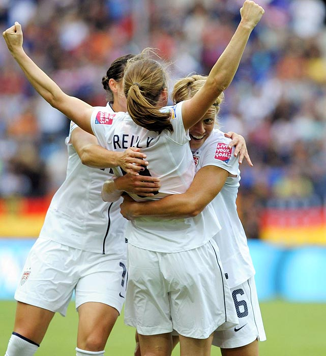Midfielder Heather O'Reilly is embraced by teammates after she gave the U.S. a 1-0 lead in the 12th minute against Colombia.