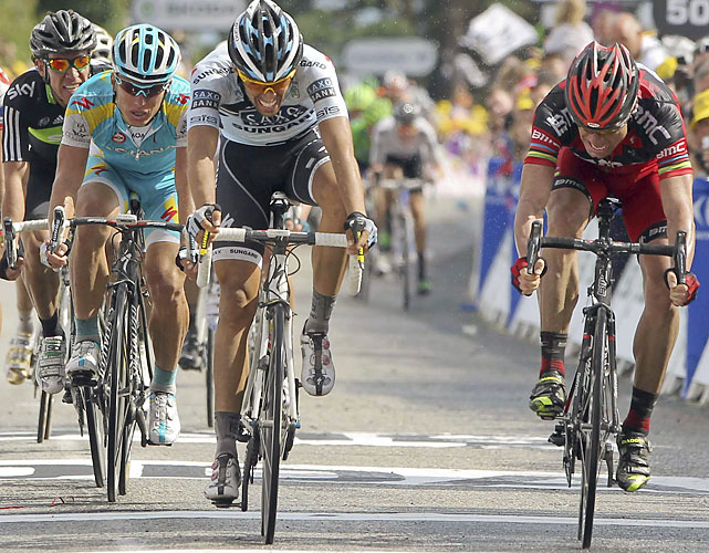 The overall contenders finally went at it, with Cadel Evans (right) edging two-time champion Alberto Contador (left) for the victory.