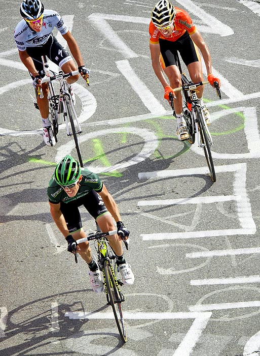 Frenchman Pierre Rolland (bottom) slid past former Tour champion Alberto Contador toward the top of a 6,100 foot final climb in the Alps to win by 14 seconds as the race headed into its last two stages.