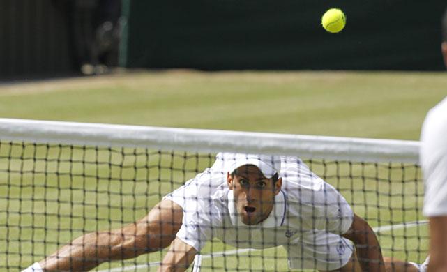 Novak Djokovic focuses on the ball during Friday's semifinal.