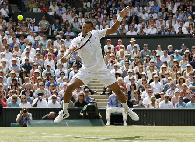 Jo-Wilfried Tsonga returns a backhand shot to Novak Djokovic.