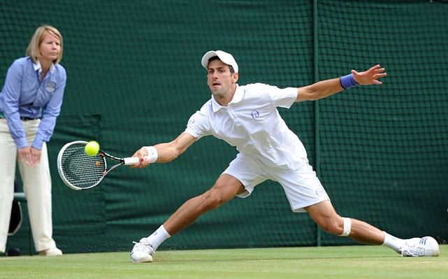 Novak Djokovic extends for a return to Jo-Wilfried Tsonga during their semifinal match.
