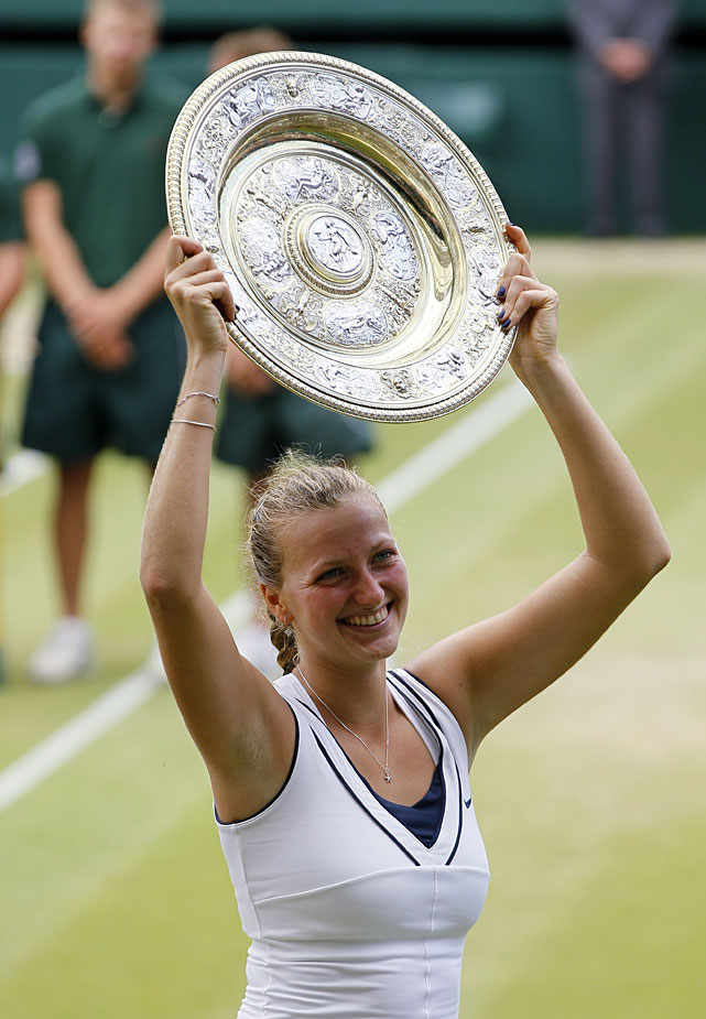 Petra Kvitova lifts the Venus Rosewater Dish after defeating Maria Sharapova in Saturday's women's final.
