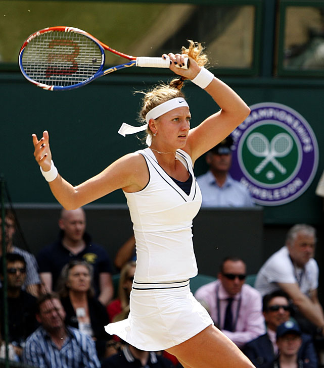 Petra Kvitova of the Czech Republic returns to Russia's Maria Sharapova during Saturday's women's singles final at Wimbledon.