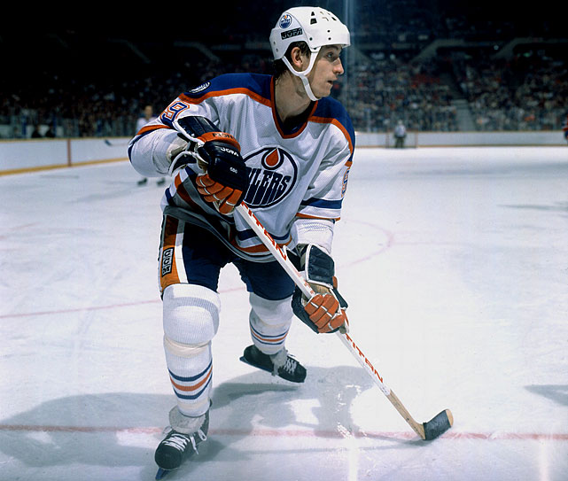 Wayne Gretzky established an NHL record with 215 points in 1985-86. He finished with 52 goals and 163 assists during his third consecutive year with at least 200 points.