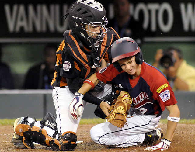 La Grange, Ky., catcher Jackson Mason tags out Clinton County, Pa.'s Tyler McCloskey in the sixth inning of their pool-play game.